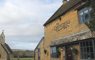 The Churchill Arms - with church in the background