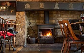 The Churchill Arms - with the woodburner glowing