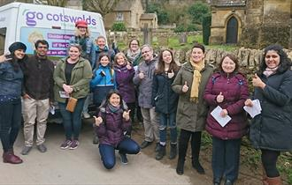A tour group enjoying a Go Cotswolds guided tour of the Cotswolds