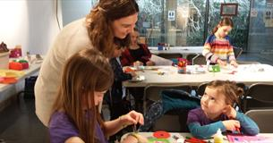Children enjoying a craft activity at the the museum