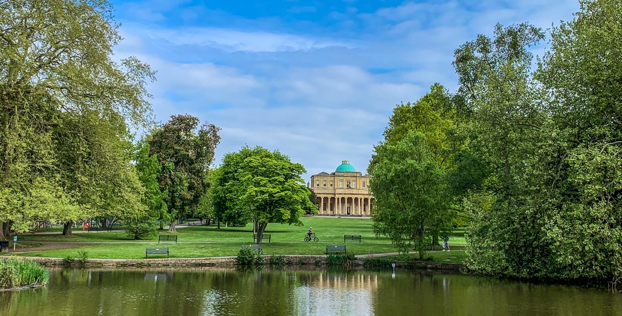 Pittville Pump Room Cheltenham across the lake